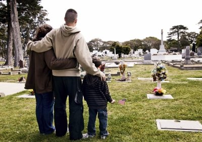 Family standing at cemetery